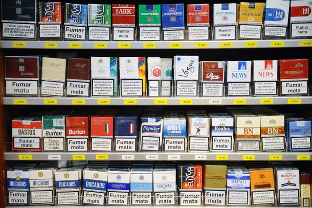 Packs of cigarettes are displayed at the checkout of a tobacconist's shop in the Spanish city of Les, located at the French-Spanish border on september 30, 2012. The tax on manufactured cigarettes as well as roll-your-own will go up by 6.5 percent on October 1st, 2012 in an increase that hasn?t been seen in France since 2004. The tax hike translates to 40 cents more per pack, with the cheapest at 6,10 euros and the most expensive coming in at more than seven euros. AFP PHOTO / REMY GABALDA