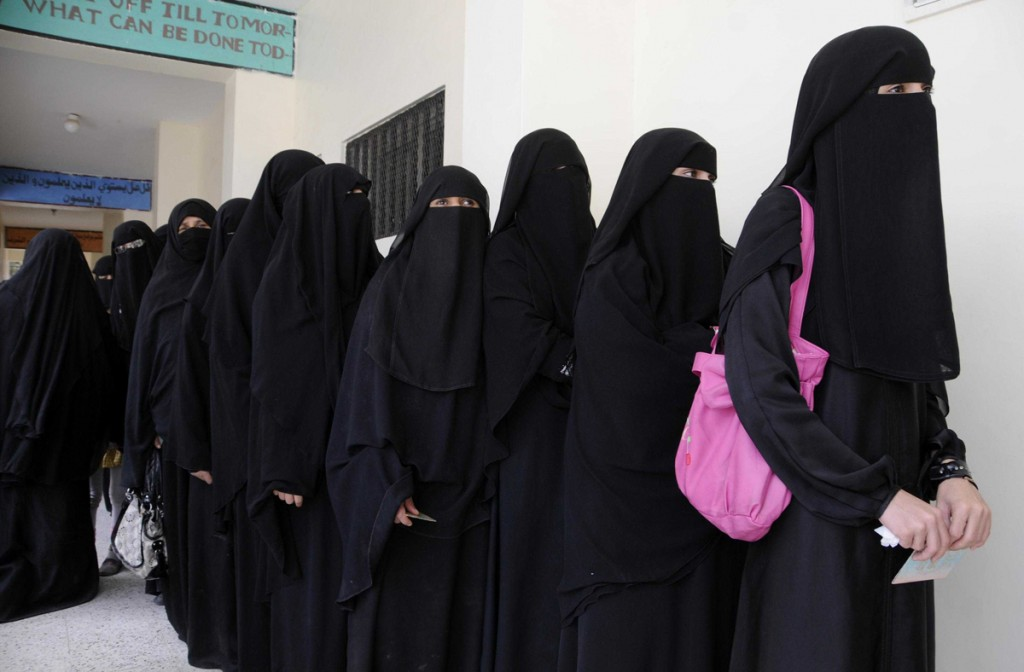 21 February 2012 - Sanaa, Yemen - Yemeni women wait to cast their ballots at a polling station in Sanaa, capital of Yemen, Feb. 21, 2012. More than 10 million eligible voters are expected to cast their ballots at about 29,000 polling stations across Yemen from 8:00 ( 0500 GMT) to 18:00 (1500 GMT), with over 100,000 soldiers guarding the process. However, a string of attacks on election committees flared up in the country's restive southern regions. Photo Credit: Mohammed Mohammed/Xinhua/Sipa Press/1202221850