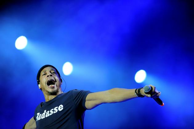 French singer JoeyStarr performs with his band Caribbean Dandee during the Vieilles Charrues music festival in Carhaix-Plouguer, western France, on July 19, 2015. AFP PHOTO / FRED TANNEAU / AFP / FRED TANNEAU