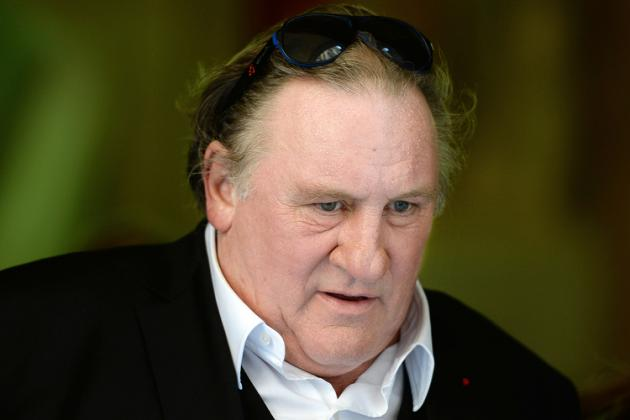 French-born actor Gerard Depardieu arrives at the city hall of Marseille, on September 1, 2015, as he takes part in the shooting of a TV movie in which he plays the mayor of Marseille. AFP PHOTO / BORIS HORVAT / AFP / BORIS HORVAT